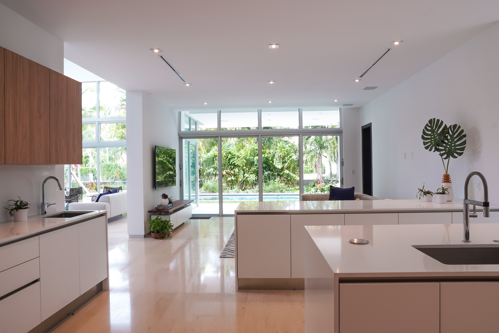 Bal Harbour Tropical Residence High-end Builder Contractor Miami Florida Luxury powder bathroom interior design kitchen dining countertop waterfall island