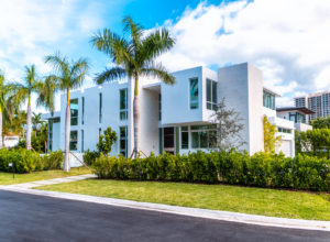 Bal Harbour Tropical Residence High-end Builder Contractor Miami Florida Luxury garage driveway concrete volume window stone tile