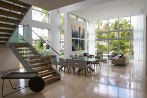 Bal Harbour Tropical Residence High-end Builder Contractor Miami Florida Luxury dining staircase glass railing limestone marble table ceiling