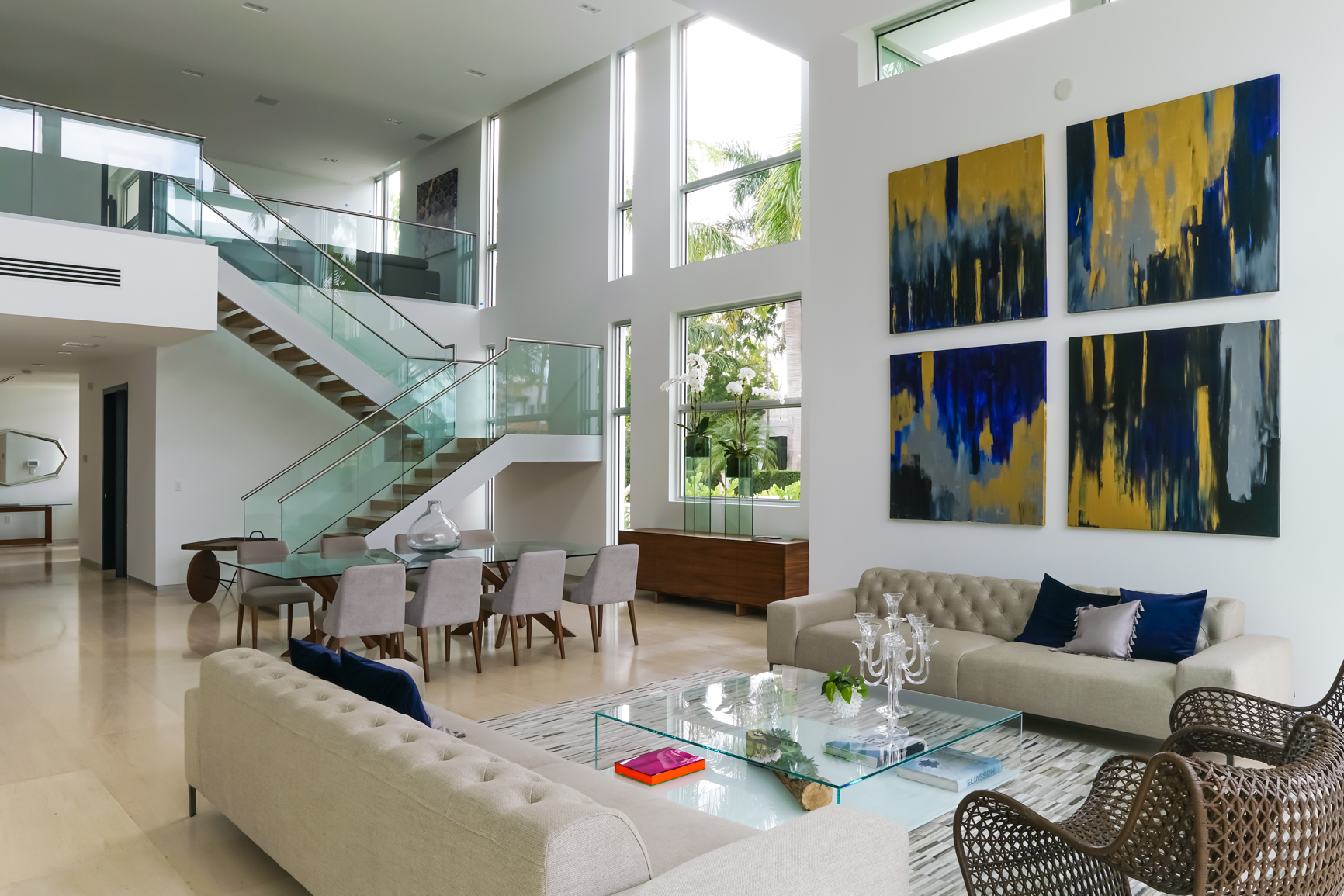 Bal Harbour Tropical Residence High-end Builder Contractor Miami Florida Luxury dining staircase glass railing limestone marble table ceiling door