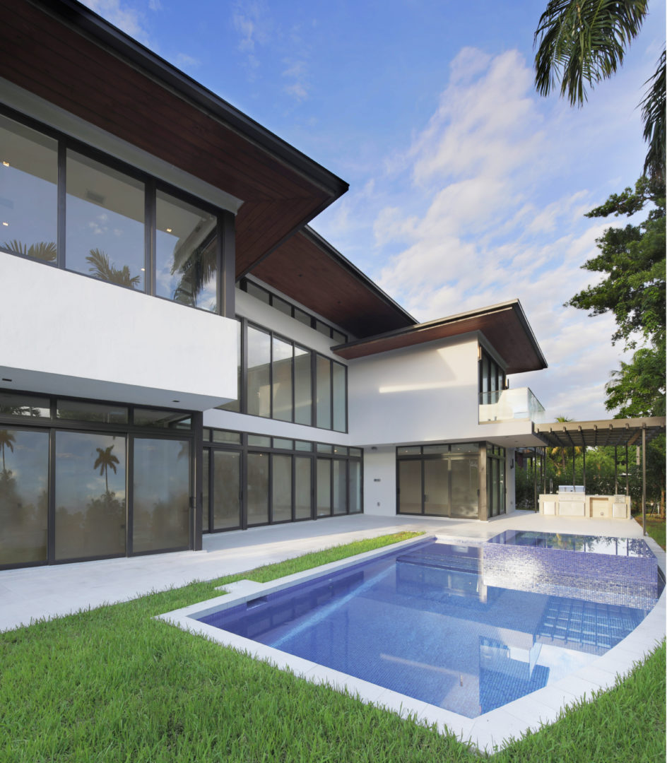 Bal Harbour Tropical Residence Modern High-end Construction pavers concrete ipe wood facade stone natural eyebrow balcony pool landscape