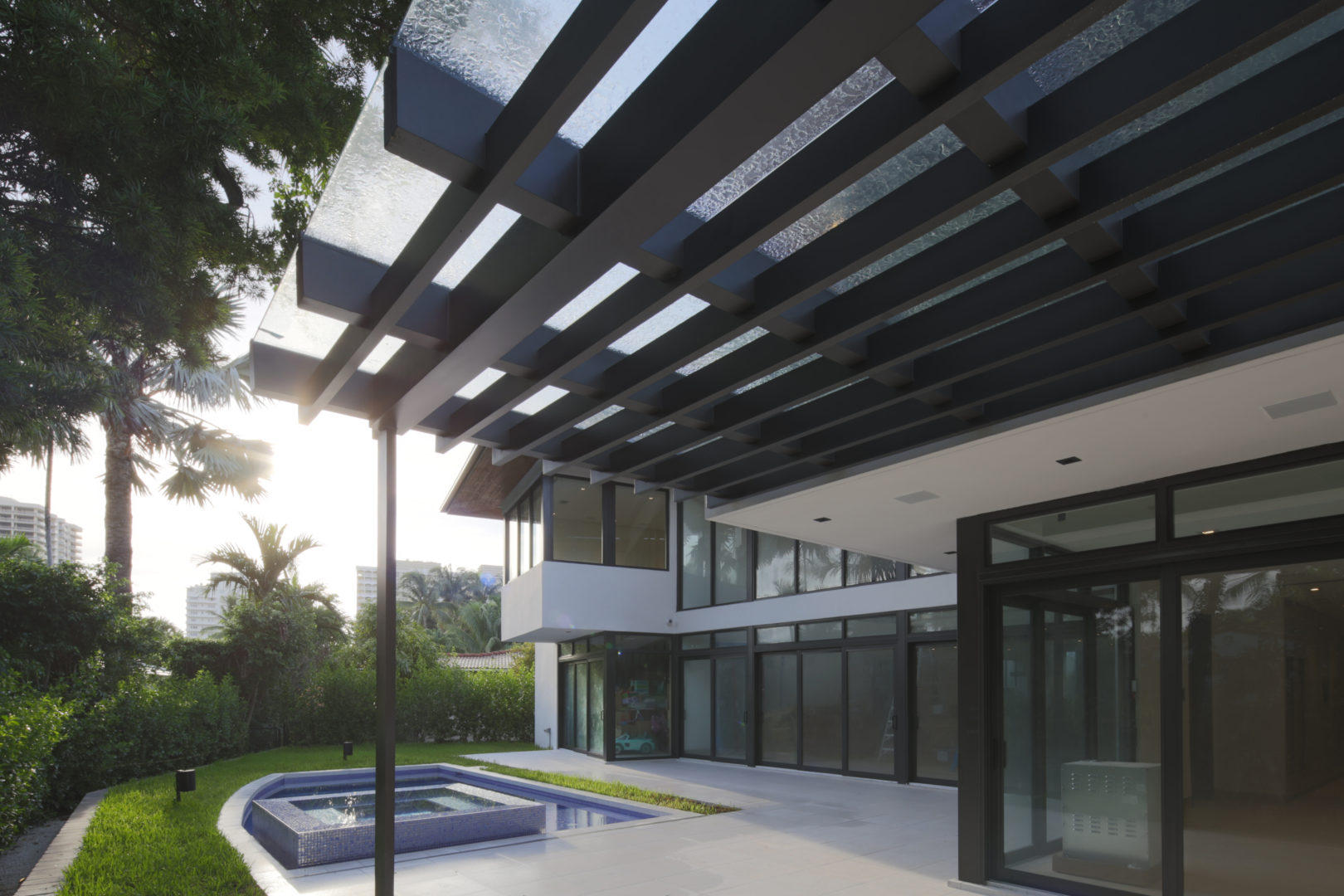 Bal Harbour Tropical Residence Modern High-end Construction pavers concrete ipe wood facade stone natural eyebrow balcony pool trellis aluminum glass cover bbq