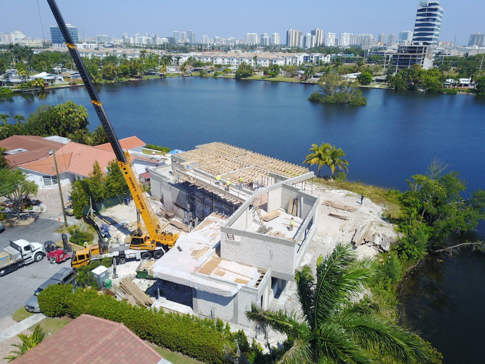miami florida house builder high-end modern new construction contractor crane