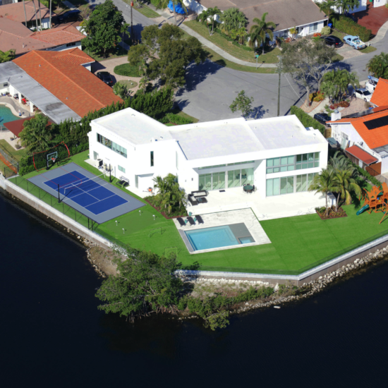 miami florida house builder high-end modern new construction contractor modern grass artificial pool playground golf sports