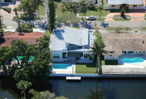 Miami florida builder white house home construction contractor aerial photo waterfront enchanted lade