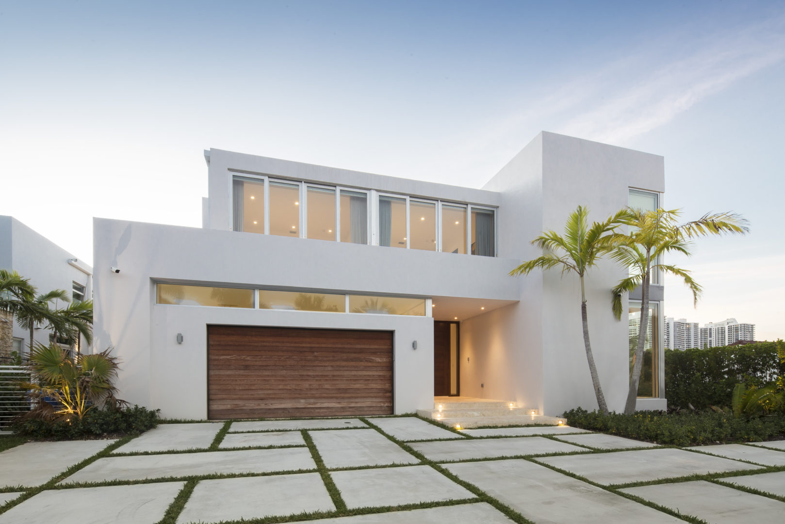Golden Beach house modern luxury high-end miami contractor builder driveway concrete landscape wood