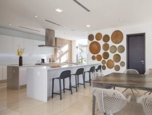 Golden Beach house modern luxury high-end miami contractor builder wood floor kitchen appliances table dining