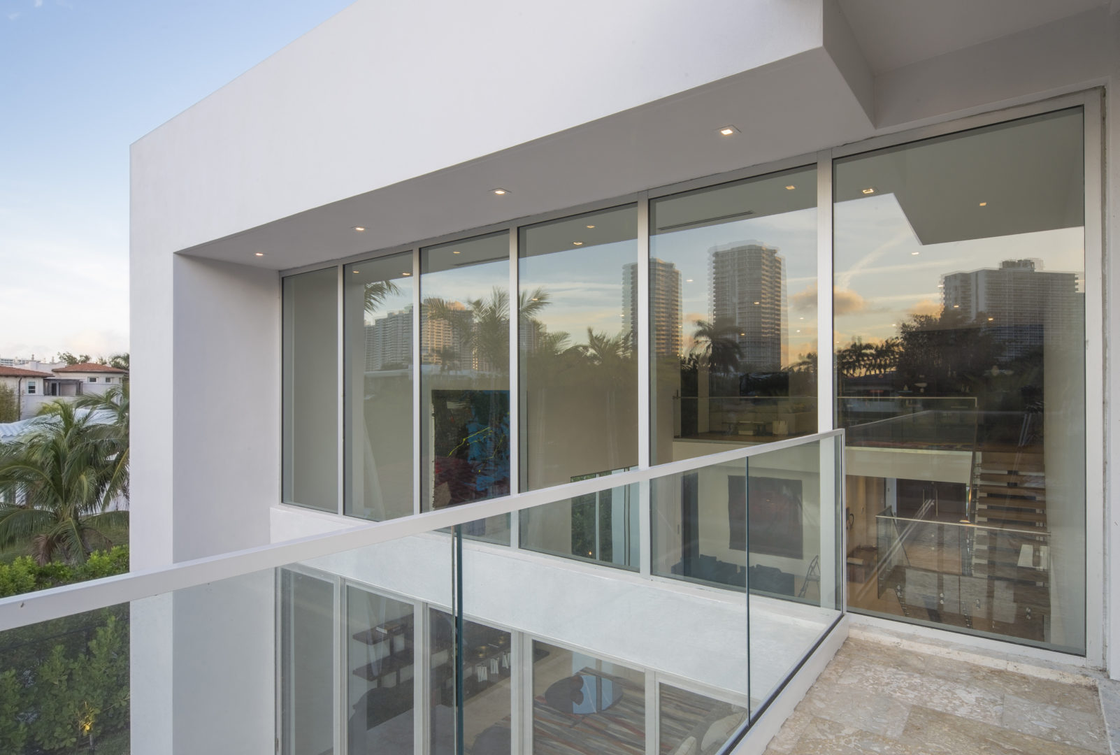 Golden Beach house modern luxury high-end miami contractor builder coral stone pool deck exterior outdoors balcony railing glass terrace