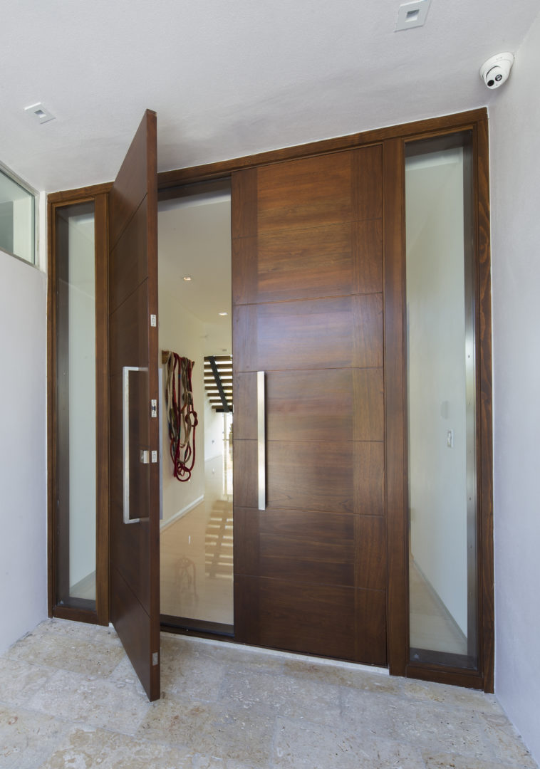 Golden Beach house modern luxury high-end miami contractor builder coral stone pool deck exterior outdoors entry door foyer