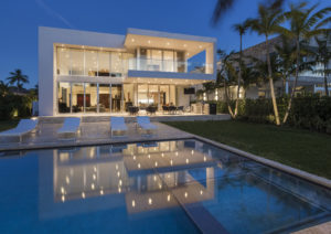 Golden Beach house modern luxury high-end miami contractor builder coral stone pool deck exterior outdoors balcony grass landscape tree night