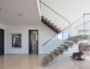 Golden Beach house modern luxury high-end miami contractor builder staircase railing wood engineered glass living floor room