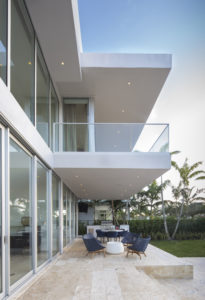 Golden Beach house modern luxury high-end miami contractor builder coral stone pool deck exterior outdoors balcony railing glass terrace cantilever