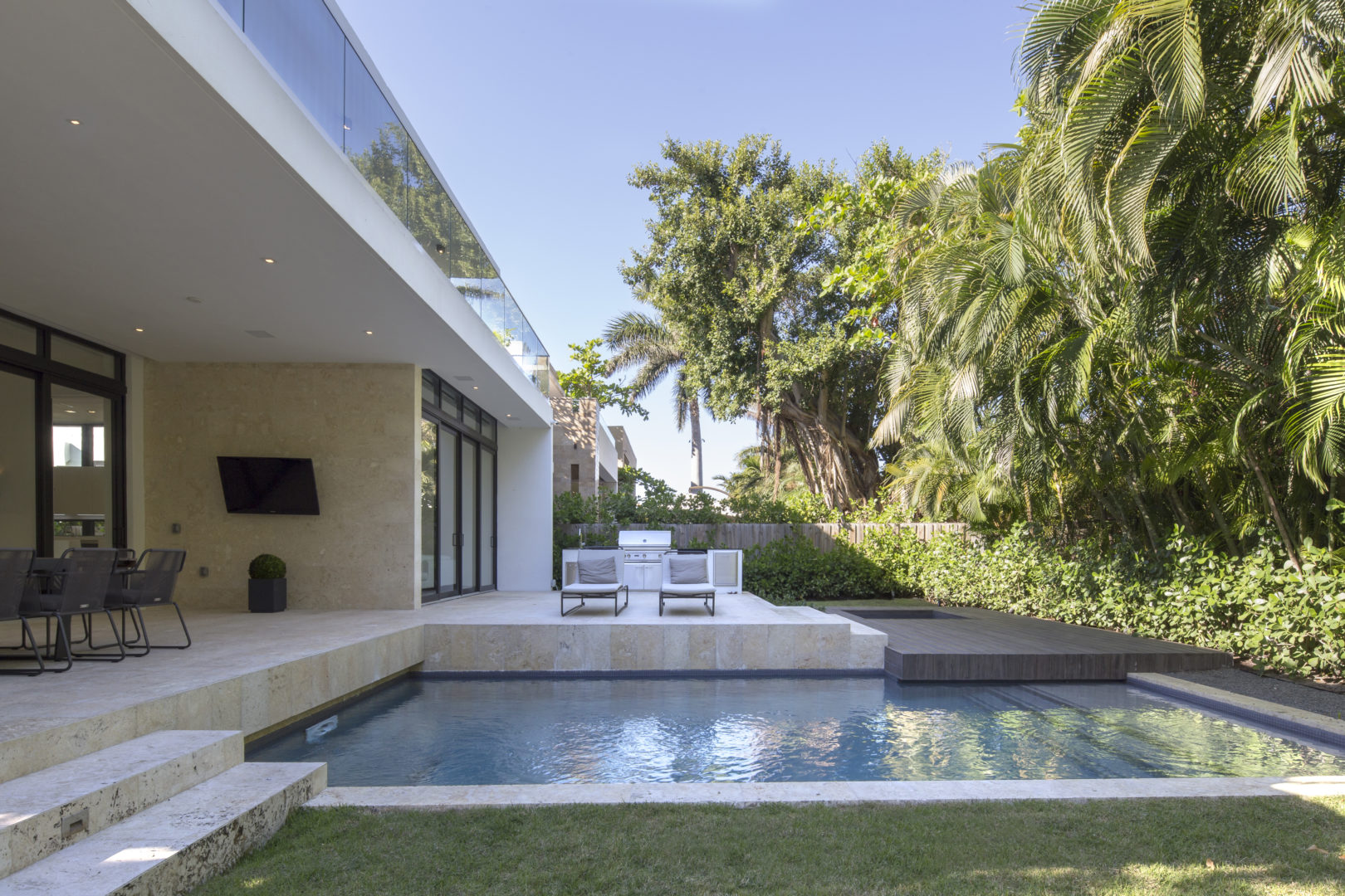 Golden Beach Residence High-end Builder Contractor Miami Modern Luxury Facade pool miami deck stone steps light grass