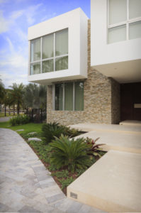 House construction miami florida custom builder contractor luxury modern residential driveway entry stone lighting