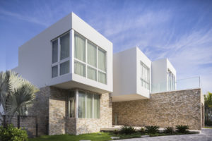 House construction miami florida custom builder contractor luxury modern residential entry volumes architecture