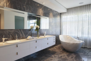House construction miami florida custom builder contractor luxury modern residential bathroom master vanity tub plumbing fixture shower mirror