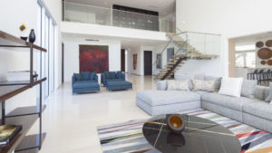 Golden Beach house modern luxury high-end miami contractor builder staircase railing wood living floor room